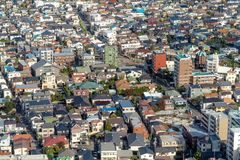 Aerial view of Tokyo apartments in cityscape background. Residential district in smart city in Asia. Buildings at noon. Japan royalty free stock image