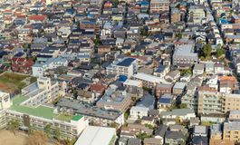 Aerial view of Tokyo apartments in cityscape background. Residential district in smart city in Asia. Buildings at noon. Japan stock photos