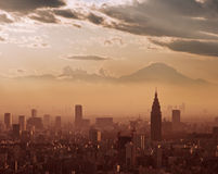 Aerial view of Tokyo at sunset, with the silhouette of Mount Fuji Royalty Free Stock Photography