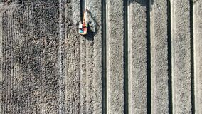 Aerial view top view of excavator working in the agricultural farm field. Drainage of agricultural. Time lapse view.