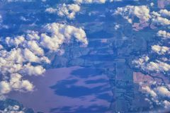 Aerial view of topographical landscapes over midwest states on flight over Colorado, Kansas, Missouri, Illinois, Indiana, Ohio an. D West Virginia during autumn stock image