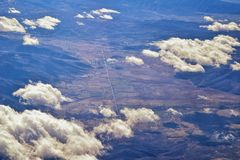 Aerial view of topographical Rocky Mountain landscapes on flight over Colorado and Utah during winter. Grand sweeping views of riv stock photos