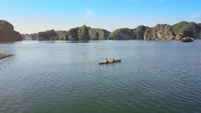 Aerial View Tourist Boats Sail Couple Row Kayak in Endless Bay. Aerial view tourist boats sail couple row kayak in tranquil endless ocean bay against rocky stock footage
