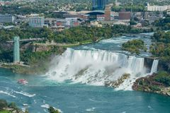 Aerial view of a tourist ship driving pass the beautiful Niagara Falls. At Canada stock image
