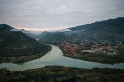 Aerial view of the tourist town Mtskheta with confluence of the Aragvi and Kura at the morning. Aerial view of the old georgian capital town Mtskheta with Royalty Free Stock Photo