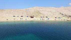 Aerial view of tourists on isolated beach of Pag island, Croatia. Aerial view of tourists on beautiful sandy beach of Pag island, Croatia stock footage