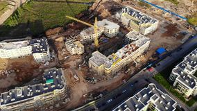 Aerial view on tower crane on construction site.  stock video footage