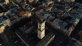 Aerial view of town hall in Lviv. Fly over market square at sunset. Cultural center of Ukraine stock video