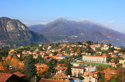 Aerial view on town among mountains on Lake Como. Royalty Free Stock Image