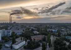 Aerial view of town, nuclear power station, thermal power station. And sky at sunset. Aerial photography. Energodar, Ukraine Royalty Free Stock Images