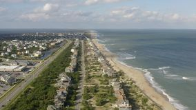 Aerial view of town, ocean and beach. 4k. Flying with drone near fancy house in Avon, NC, USA. Aerial footage of ocean, beach and city stock video