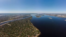 Aerial view on small town. Many houses, roads. Aerial view on town and river Volga stock photo