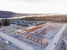 An aerial view of a townhouse complex and a new development under construction nearby in North Vancouver, BC. stock image