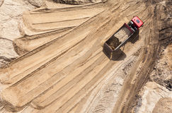 Aerial view of the  track  and earth mover tracks on sand Stock Photography