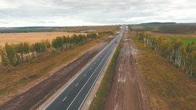 Aerial view on tracks between agriculture fields. Aerial view of arable land and road stock video