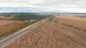 Aerial view on tracks between agriculture fields. Aerial view of arable land and road stock video footage