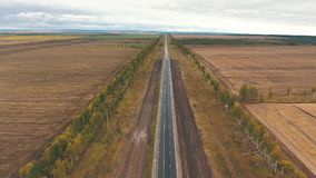Aerial view on tracks between agriculture fields stock footage