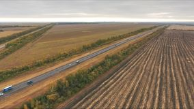Aerial view on tracks between agriculture fields. Aerial view of arable land and road stock footage