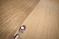 Aerial view of the tractor harrowing the field Stock Image
