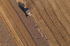 Aerial view of tractor on harvest fields Royalty Free Stock Photo