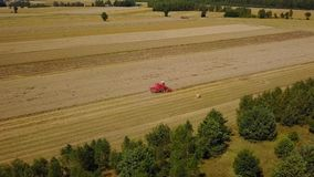 Aerial view on a tractor at harvest time stock video