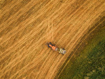 Aerial view of tractor making hay bale rolls in field Stock Photos