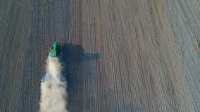 Aerial view on tractor ploughing field. Royalty Free Stock Image