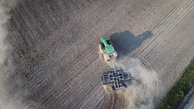 Aerial view on tractor ploughing field. Royalty Free Stock Photos