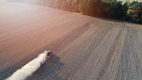 Aerial view on tractor ploughing field. Royalty Free Stock Photography