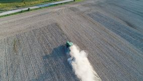 Aerial view on tractor ploughing field. Royalty Free Stock Photo