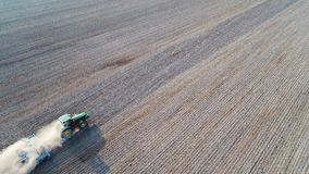 Aerial view on tractor ploughing field. Royalty Free Stock Images