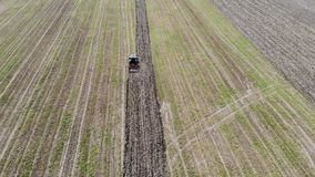 Aerial view of tractor plowing the field stock video footage