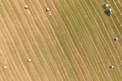 Aerial view of tractor with round baler on field Royalty Free Stock Photo