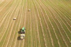 Aerial view of tractor with round baler on field Royalty Free Stock Photography