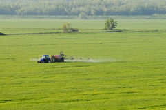 Aerial view of tractor spraying substances Royalty Free Stock Photography