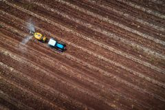 Aerial view of tractor spraying vineyard with fungicide.  stock photos