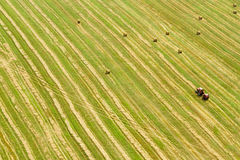 Aerial view of tractor working in a field Stock Photos