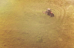 An aerial view of tractor working Royalty Free Stock Photo