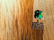 Aerial view on the tractor working on the tulip field stock images
