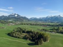 Aerial view of Bavarian landscape close to the alps. Aerial view of traditional Bavarian landscape close to the alps with blue sky stock images