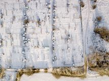 Aerial view of traditional English allotments and public park land covered in snow, frost and ice, looking down. Frozen landscape after a snow blizzard across stock photos