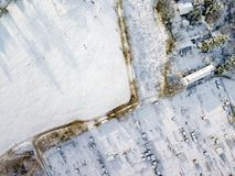 Aerial view of traditional English allotments and public park land covered in snow, frost and ice, looking down. Frozen landscape after a snow blizzard across stock photography