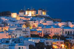 Traditional windmills at sunset, Santorini, Greece royalty free stock image