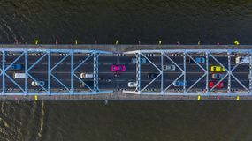Aerial view on traffic bridge over river, cars on bridge royalty free stock photo