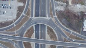Aerial view of traffic circle roundabout, cars driving on flat grey asphalt by highway stock footage