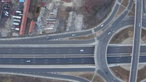 Aerial view of traffic circle roundabout, interstate bridges crossing at large highway junction stock footage