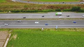 Aerial view of traffic on a highway, drone footage. Aerial view of traffic on a highway - tracking shot, drone footage stock footage