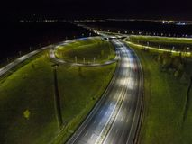 Aerial view of the traffic intersection outside the city at night. Russia Royalty Free Stock Photography