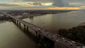 Aerial view with traffic jam on bridge over the river. Russia stock footage