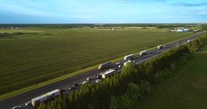 Aerial traffic jam due to accident on country road. Aerial view traffic jam due to auto accident on highway among pictorial countryscape with fields stock video footage